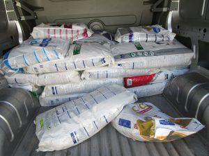 bags of dog food in van