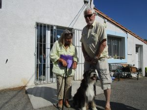Couple with hairy dog