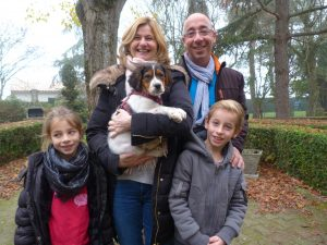 family of 4 carrying puppy Lyndee