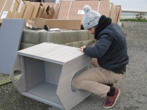 man building kennel