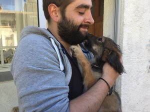 puppy in man's arms