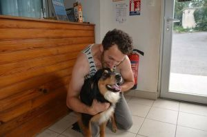 hairy dog in arms of loving owner