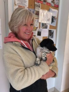 pup in woman's arms