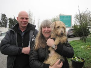 scruffy dog with couple