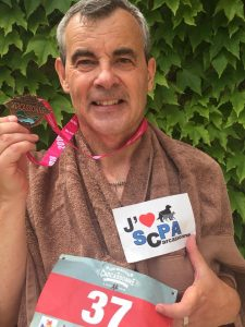 man holding medal